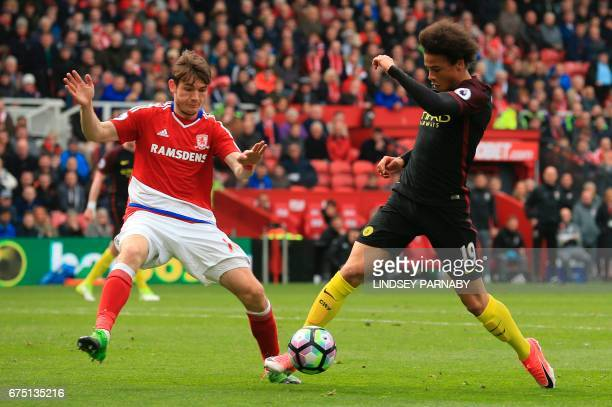 Middlesbrough's Dutch midfielder Marten de Roon challenges Manchester City's German midfielder Leroy Sane to concede a penalty during the English...