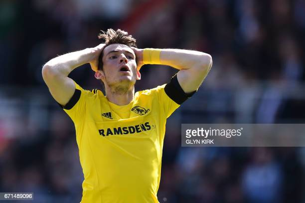 Middlesbrough's Dutch midfielder Marten de Roon reacts after missing a shot on goal during the English Premier League football match between...