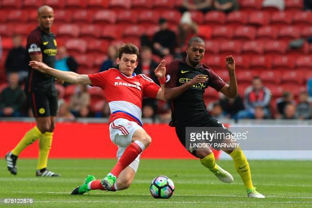 Middlesbrough's Dutch midfielder Marten de Roon vies with Manchester City's Brazilian midfielder Fernandinho during the English Premier League...