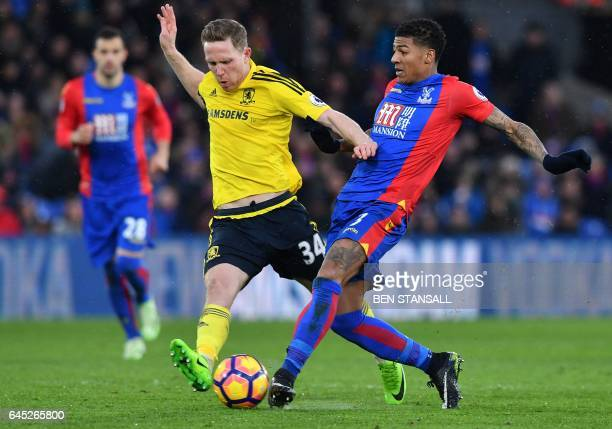 Middlesbrough's English midfielder Adam Forshaw vies with Crystal Palace's Dutch defender Patrick van Aanholt during the English Premier League...