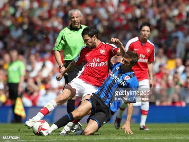 Middlesbrough's Gary O'Neiltackles Arsenal's Francesc Fabregas in a battle for the ball