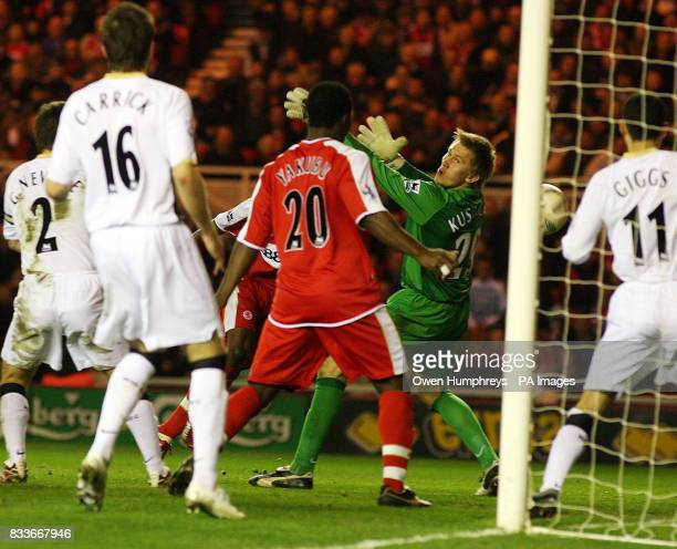 Middlesbrough's George Boateng scores past Manchester United goalkeeper Tomasz Kuszczak during the FA Cup quarterfinal match at the Riverside Stadium...