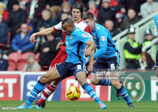 Middlesbroughs George Friend and Leeds United's Rodolph Austin and Luke Murphy during the Sky Bet Championship match at the Riverside Stadium...