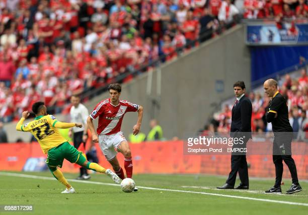 Middlesbrough's George Friend and Norwich City's Nathan Redmond compete for the ball as Norwich Manager Alex Neil and Middlesbrough Manager Aitor...