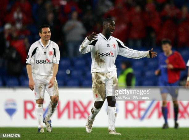 Middlesbrough's Jimmy Floyd Hasselbaink show his dejection with Doriva after FC Basle score their second goal during the UEFA Cup QuarterFinal...