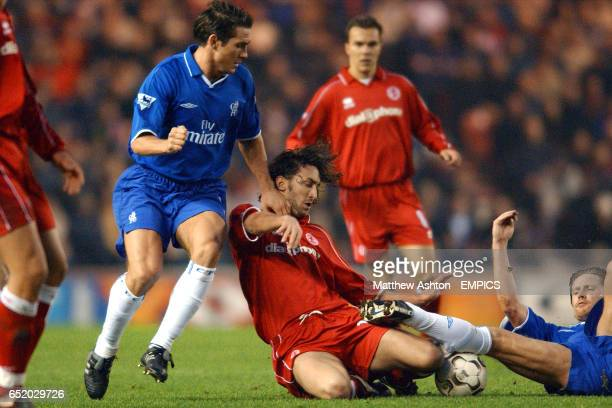 Middlesbrough's Jonathan Greening battles for the ball with Chelsea's Frank Lampard and Emmanuel Petit