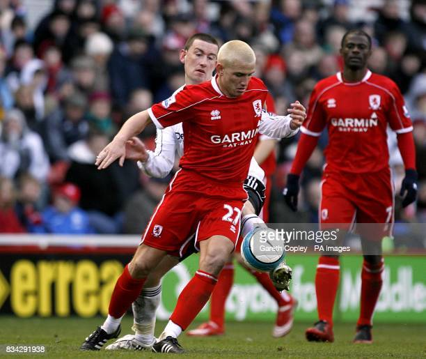 Middlesbrough's Lee Cattermole and Derby County's David Jones battle for the ball
