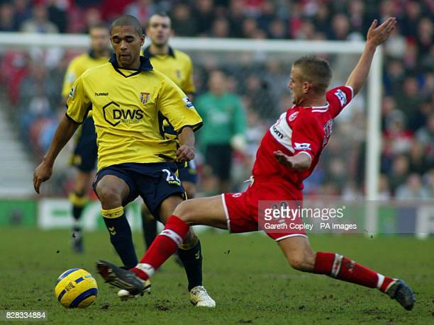 Middlesbrough's Lee Cattermole challenges Aston Villa's Luke Moore