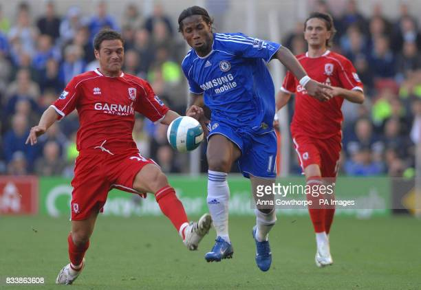 Middlesbrough's Luke Young and Chelsea's Didier Drogba battle for the ball during the Barclays Premier League match at the Riverside Stadium...