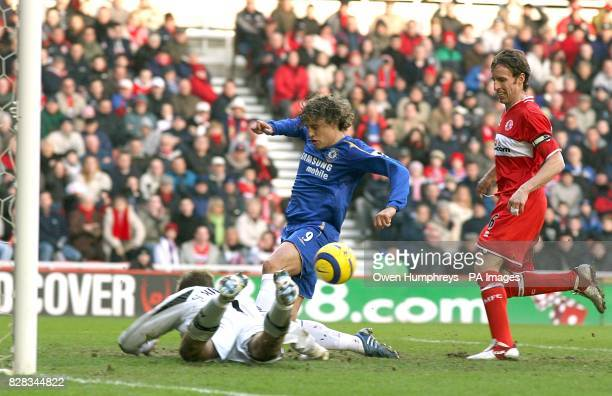 Middlesbrough's Mark Schwarzer saves bravely at the feet of Chelsea's Hernan Crespo after only being able to parry a swerving shot from Michael Essien