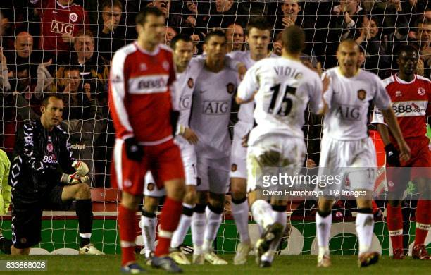 Middlesbrough's Mark Schwarzer sits dejected after failing to save a penalty from Manchester United's Cristiano Ronaldo