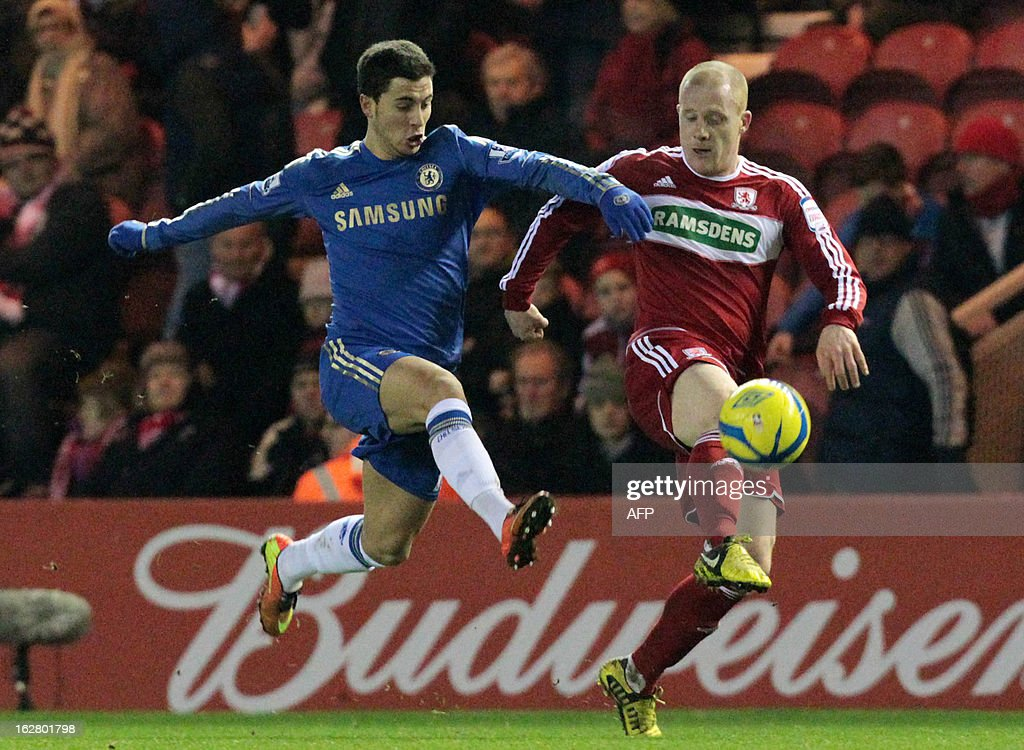 """Middlesbrough's Nicky Bailey (R) vies for the ball with Chelsea's Eden Hazard during the English FA Cup fifth round football match between Middlesbrough and Chelsea at the Riverside stadium in Middlesbrough, northeast England, on February 27, 2013. Chelsea won the match 2-0. USE. No use with unauthorized audio, video, data, fixture lists, club/league logos or """"live"""" services. Online in-match use limited to 45 images, no video emulation. No use in betting, games or single club/league/player publications."""