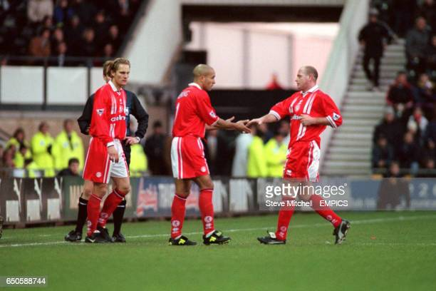 Middlesbrough's Paul Gascoigne shakes hands with Curtis Fleming as he leaves the pitch after being substituted