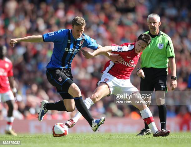 Middlesbrough's Robert Huth and Arsenal's Samir Nasri battle for the ball