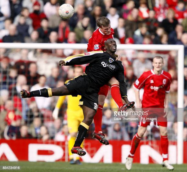 Middlesbrough's Robert Huth and Cardiff City's Jimmy Floyd Hasselbaink battle for the ball