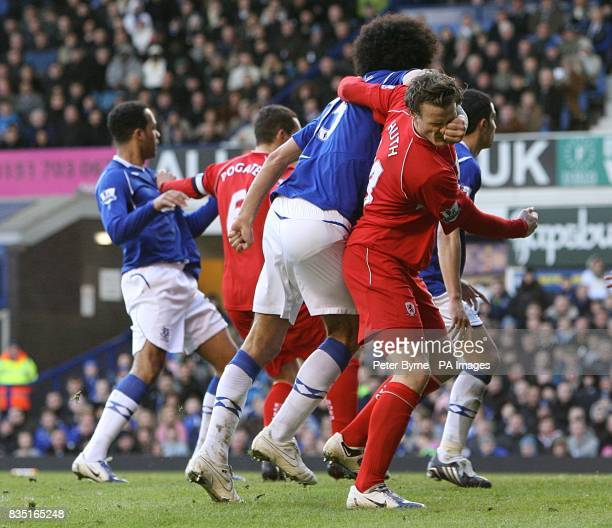 Middlesbrough's Robert Huth and Everton's Marouane Fellaini tussle in the penalty area