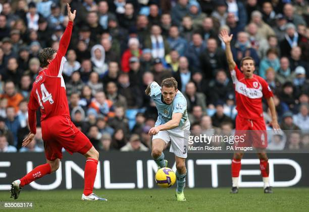 Middlesbrough's Robert Huth and Gary O'Neil appeal for a decision as Manchester City's Craig Bellamy maintains possession