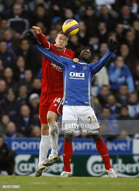 Middlesbrough's Robert Huth and Portsmouth's Benjani Mwaruwari battle for the ball