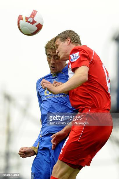 Middlesbrough's Robert Huth and Portsmouth's Peter Crouch battle for the ball