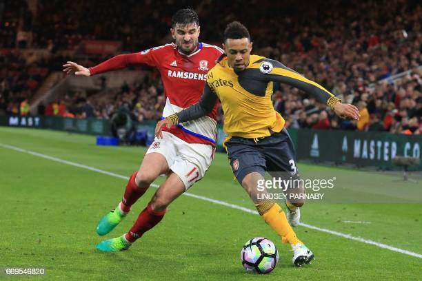 Middlesbrough's Spanish defender Antonio Barragan vies with Arsenal's French midfielder Francis Coquelin during the English Premier League football...