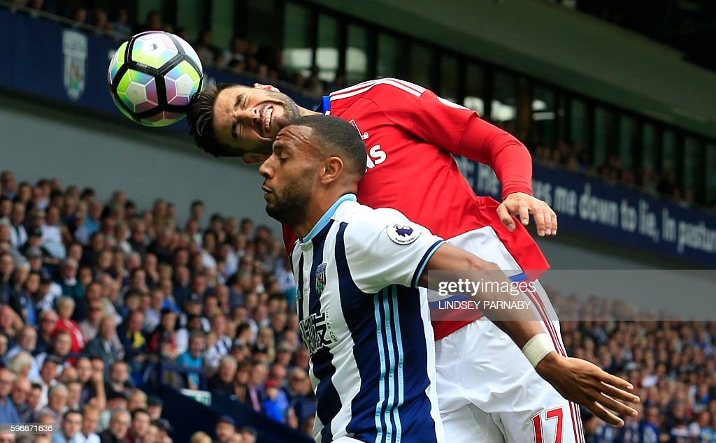 TOPSHOT - Middlesbrough's Spanish defender Antonio Barragan (up) wins a header from West Bromwich Albion's English-born Scottish midfielder Matt Phillips during the English Premier League football match between West Bromwich Albion and Middlesbrough at The Hawthorns stadium in West Bromwich, central England, on August 28, 2016. / AFP / Lindsey PARNABY / RESTRICTED TO EDITORIAL USE. No use with unauthorized audio, video, data, fixture lists, club/league logos or 'live' services. Online in-match use limited to 75 images, no video emulation. No use in betting, games or single club/league/player publications. /