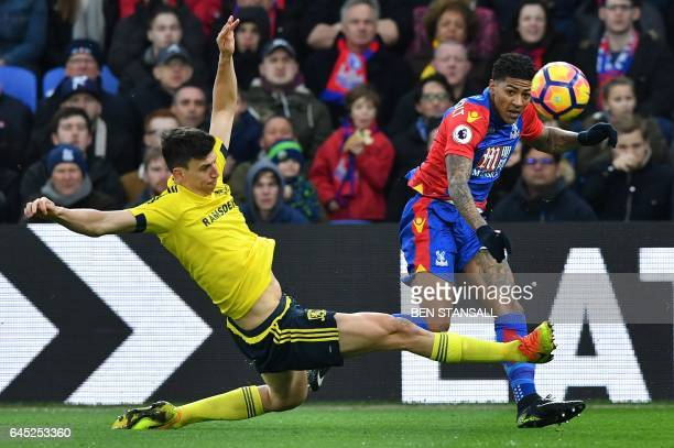 Middlesbrough's Spanish defender Daniel Ayala vies with Crystal Palace's Dutch defender Patrick van Aanholt during the English Premier League...