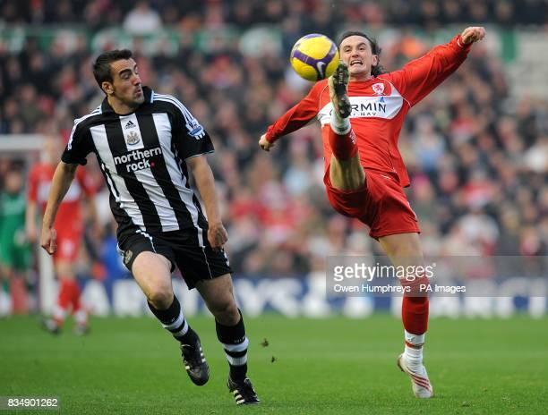Middlesbrough's Tuncay Sanli and Newcastle United's Sanchez Jose Enrique battle for the ball