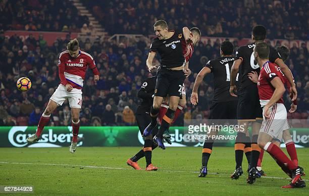 Middlesbrough's Uruguayan midfielder Gaston Ramírez heads the ball to scores his team's first goal during the English Premier League football match...