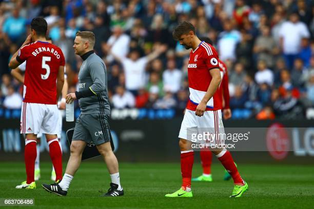 Middlesbrough's Uruguayan midfielder Gaston Ramírez leaves the pitch after picking up an injury during the English Premier League football match...