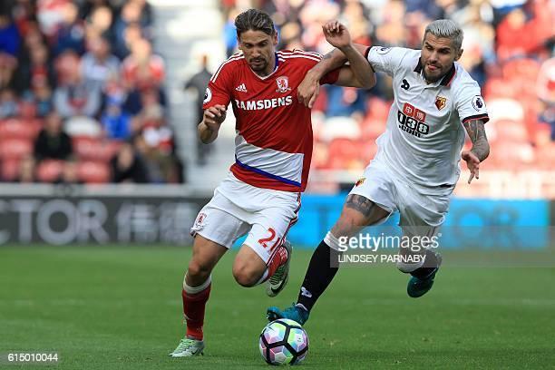 Middlesbrough's Uruguayan midfielder Gaston Ramírez vies with Watford's Yugoslavianborn Swiss midfielder Valon Behrami during the English Premier...