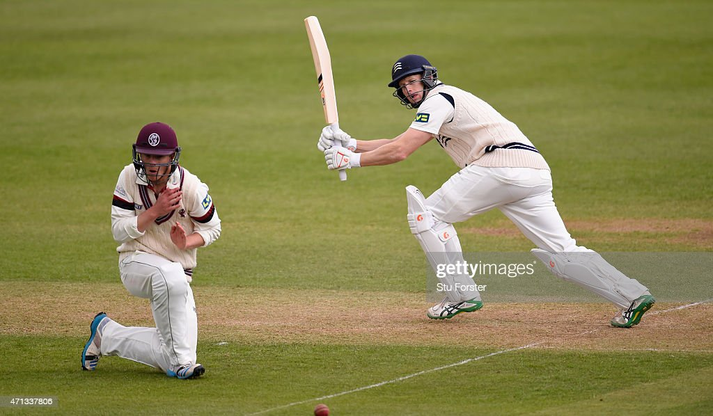 Middlesex batsman <a gi-track='captionPersonalityLinkClicked' href=/galleries/search?phrase=Adam+Voges&family=editorial&specificpeople=724770 ng-click='$event.stopPropagation()'>Adam Voges</a> hits a boundary past short leg fielder Tom Abell of Somerset during day two of the Division One LV County Championship match between Somerset and Middlesex at The County Ground on April 27, 2015 in Taunton, England.