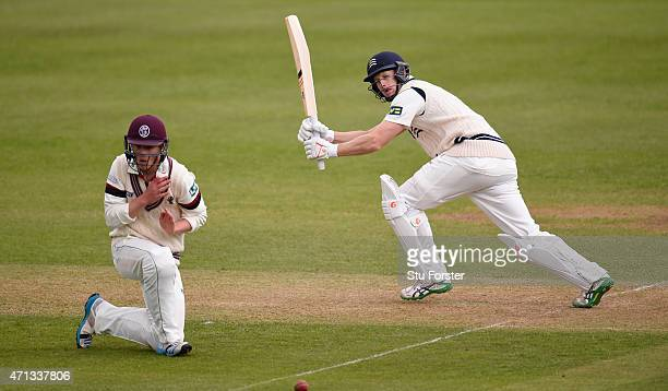 Middlesex batsman Adam Voges hits a boundary past short leg fielder Tom Abell of Somerset during day two of the Division One LV County Championship...