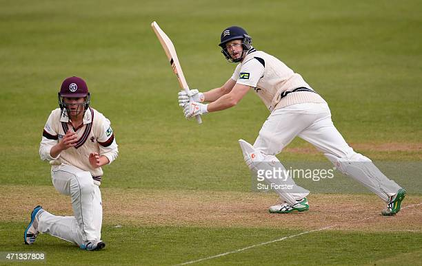 Middlesex batsman Adam Voges hits a boundary past short leg fielder Tom Abell during day two of the Division One LV County Championship match between...