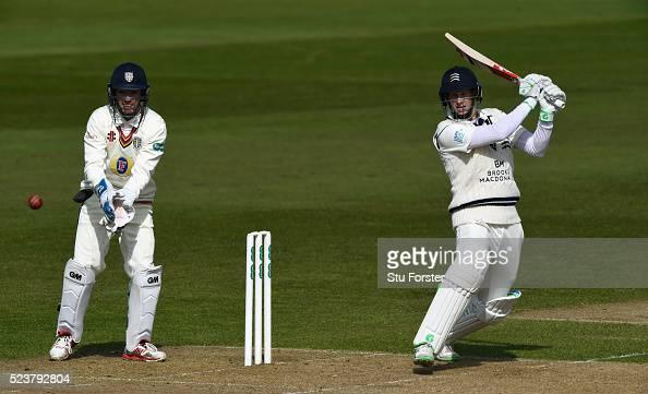Middlesex batsman Adam Voges hits out as Michael Richardson looks on during day one of the Specsavers County Championship Division One match between...