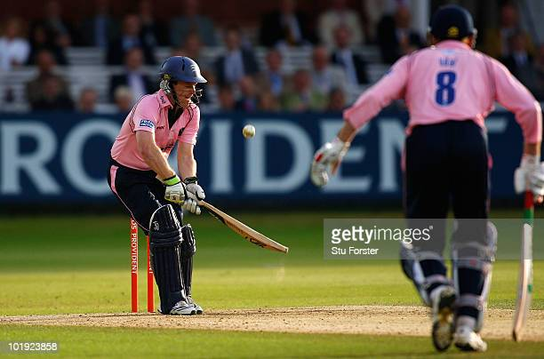 Middlesex batsman Eoin Morgan improvises to send the ball over the wicketkeepers head to the boundary during the Friends Provident T20 match between...