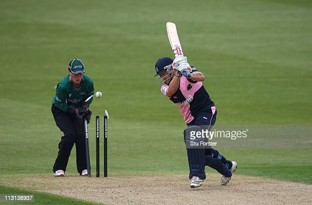 Middlesex batsman Gareth Berg is bowled as wicketkeeper Ben Cox looks on during the Clydesdale Bank 40 match between Worcestershire Royals and...