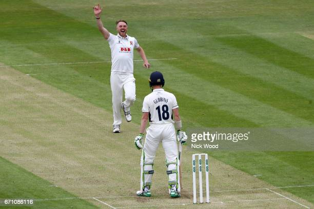 Middlesex batsman Nick Gubbins stands his ground as Jamie Porter of Essex celebrates a wicket at Lords Cricket Ground on April 21 2017 in London...
