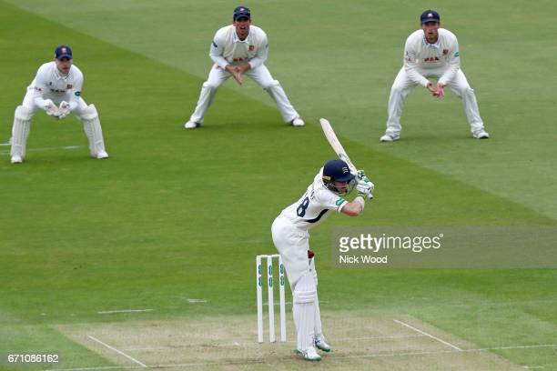 Middlesex batsman Nick Gubbins tries to avoid the ball as it hits his leg at Lords Cricket Ground on April 21 2017 in London England