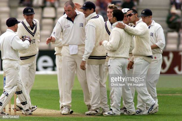 Middlesex bowler Angus Fraser and Phil Tufnell congratulate wicketkeeper David Nash for catching Hampshire skipper Robin Smith during the CricInfo...
