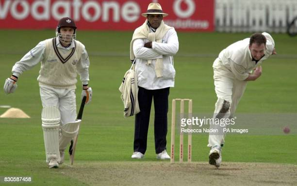Middlesex captain Angus Fraser bowls as former Middlesex player Mark Ramprakash waits to run for Surrey during the Benson Hedges Cup match at The Oval