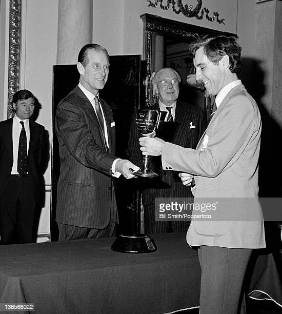 Middlesex captain Mike Brearley receives the County Championship trophy from the The Lord's Taverners' 'twelfth man' HRH the Duke of Edinburgh during...