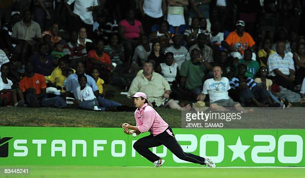 Middlesex cricketer Ed Joyce drops a catch against England during their match of the Stanford 20/20 cricket tournament at the Standford Stadium in St...