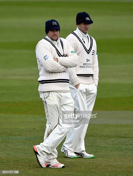 Middlesex fielder Dawid Malan and captain Adam Voges attempt to keep warm as the temperatures dip during day two of the Specsavers County...