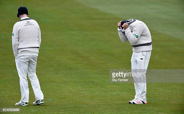 Middlesex fielder Dawid Malan attempts to keep warm with captain Adam Voges as the temperatures dip during day two of the Specsavers County...