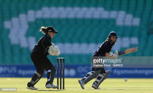 Middlesex Women's Catherine Dalton hits out past Surrey Women's wicketkeeper Kirstie White