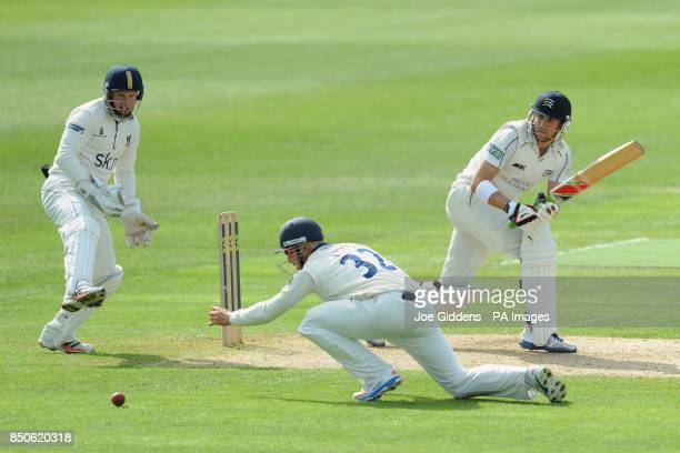 Middlesex's Dawid Malan knocks the ball past Warwickshire's Lawrie Evans during the LV= County Championship Division One match at Edbaston Birmingham