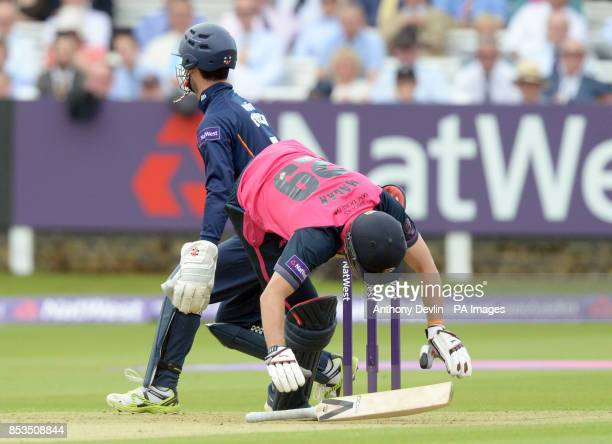 Middlesex's Dawid Malan loses his footing during the Natwest T20 Blast South Division match at Lord's Cricket Ground London