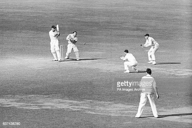 Middlesex's Jack Robertson edges a ball from Surrey's Jim Laker towards the slips watched by Surrey wicketkeeper Arthur McIntyre
