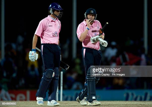 Middlesex's Steven Finn and Alan Richardson leave the field after losing to Stanford Superstars during the Stanford Super Series match at Stanford...