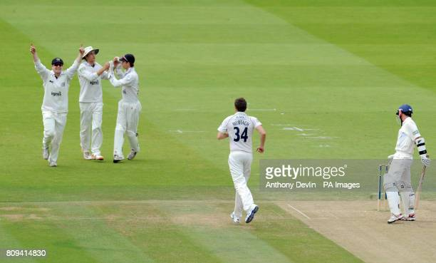 Middlesex's Tim Murtagh celebrates taking the wicket of Derbyshire's Wayne Madsen for 0 during the LV= County Championship Division Two match at...